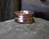 Copper and Silver Spinner Ring with Hammered finish.