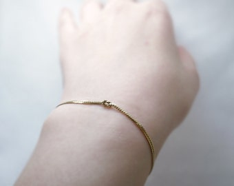 Tiny gold knot bracelet - snake chain knot in raw brass - modern delicate jewelry