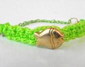 Neon green woven cord bracelet, metallic gold tone fish, dyed green chain