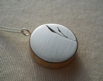 Sterling Silver necklace with  bamboo leaf cut out on  cherry wood. Makes a great birthday gift for friend, mom, sister.