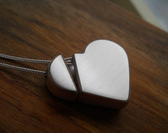 contemporay sterling silver and teak wood heart on the mend necklace.A fresh water pearl as an accent.  Makes a great gift