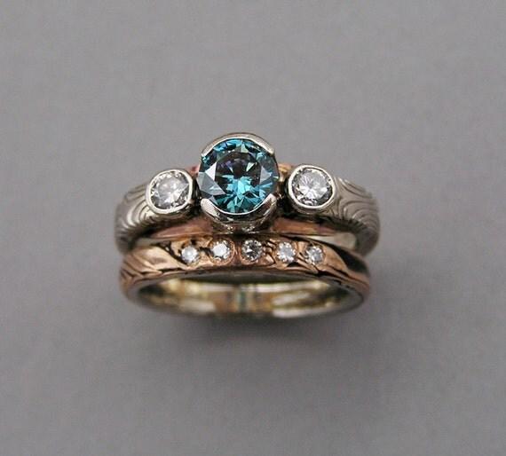Mokume gane wedding set with a Blue diamond.