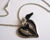 Black winged heart and charm necklace