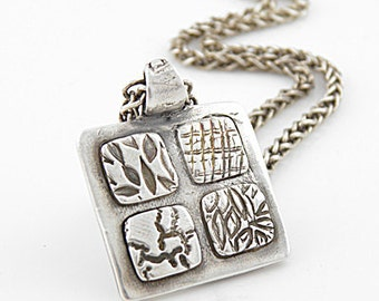 Pure Silver Four Corners of the Earth Pendant