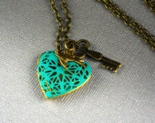 Hand Patina Heart Shaped Caged Key Bird Locket