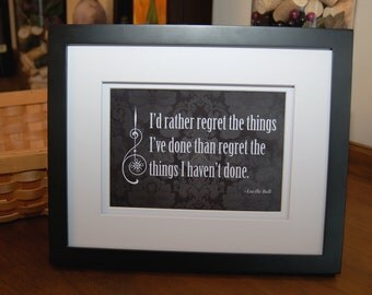 "Framed quote by Lucille Ball, ""I'd rather regret the things I've done than the things I haven't done."""