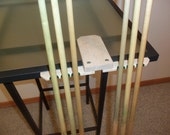 Table edge pool stick rest or rack