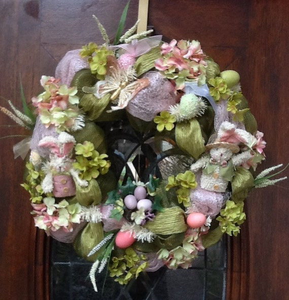 Pastel color deco mesh Easter wreath with antique looking Easter bunnies