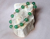 Green stone bead bracelet  with rose gold pl clasp.FREE SHIPPING