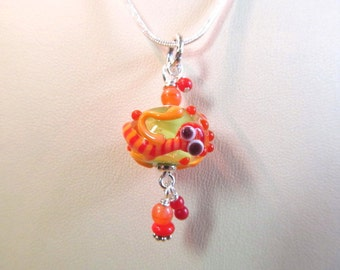 Necklace glass lizard pendant red, melon and lime lampwork
