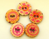 Five spring wood buttons in orange and pink colors  on natural background 1011