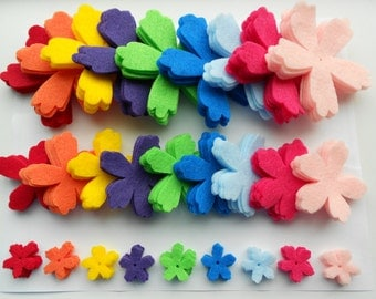 135 die cut out felt flower pieces- 9 colors, 3 sizes, 5 of each.  Neon skittle rainbow spring summer colors - lotus azalea shape