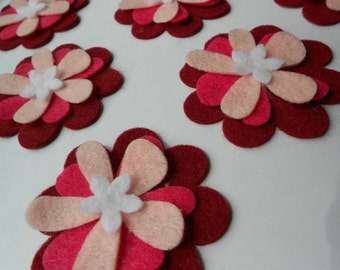 24 pieces of die cut felt flower cut outs- 6 of each shown.  FUN FLOWER SET 4.  Ombre look burgundy magenta pink and white center.