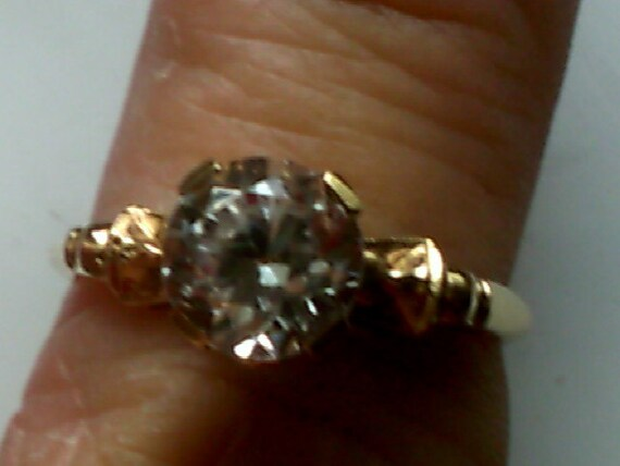 Engagement ring in 14kt yellow gold and 1.20ct  YAG diamond simulant