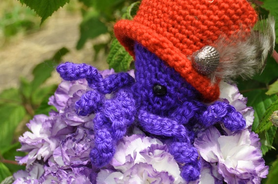 Maude, the purple octopus in a red hat amigurumi doll