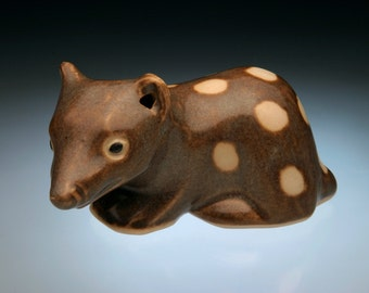 Animal sculpture of a Spotted Tailed Quoll; relative of the Tasmanian Devil; becoming a rare animal due to habitat loss.