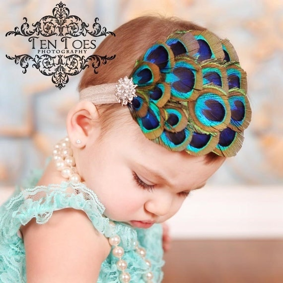 Gorgeous Nagorie Peacock Feather Headband with stunning crystal detail on soft elastic or clip.