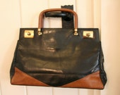 Black and brown vintage leather handbag with wooden handles