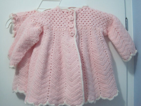 Three piece hand knit baby girls outfit
