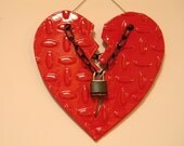 Metal diamond plate chained heart sculpture.