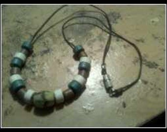 Two Necklaces....One Southwestern Bead...And One Beaded Glass....
