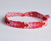 Floss friendship bracelet, modified diamond/chevron, monochrome, red, pink, with toggle clasp - RESERVED for Vivian
