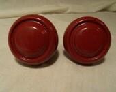Vintage red metal door knobs.