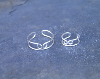 "Ear cuff, toe ring... ""Coming together"" silver wire wrapped toe ring and ear cuff set."