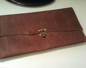 Personalized hand stitched leather clutch