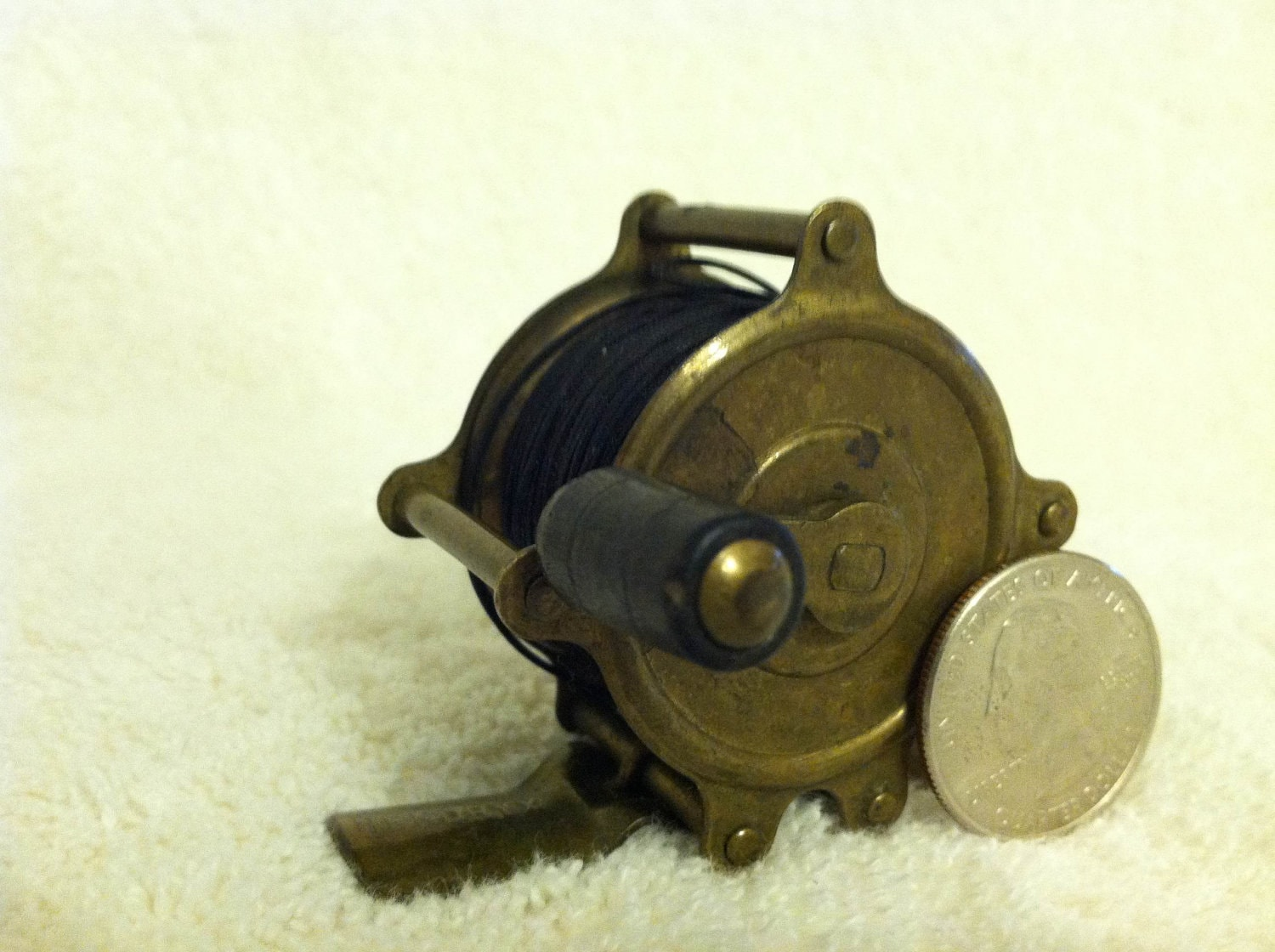 Vintage brass fly fishing reel made by hendryx for Antique fishing reels
