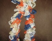 Hand knitted scarf using - Sundance Frill Mesh Yarn- Maritime- Broncos team colors