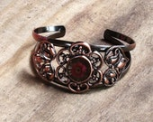 Copper bracelet with flower detail