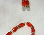 Red and clear glass beads bracelet and earrings set