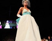 Deep V-neck wedding gown with A-line skirt and blue Tiffany waistband and bow with train