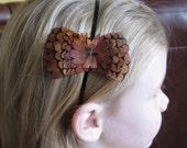 "Handmade natural feathered bow shaped headband.(2 3/4"" wide)"