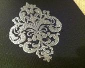 Ornate fleur-de-lis card