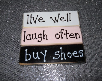 Live well  laugh often  buy shoes  wooden stackable blocks