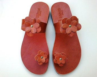Brown Leather Sandals decorated with leather flowers.