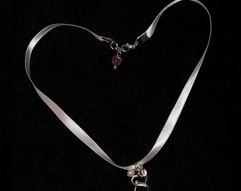 Necklace...Double Silver Heart charms strung on a lovely satin pastel pink 18 inch ribbon, a silver clasp, pearl and glass beads, NE001