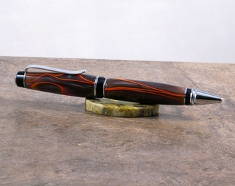 Hand turned Chrome finish Cigar  style double twist pen in midnight racer acrylic.
