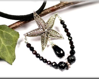 "Pendant ""black starfish"" made of sterling silver and faceted onyx"