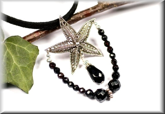 """Pendant """"black starfish"""" made of sterling silver and faceted onyx"""