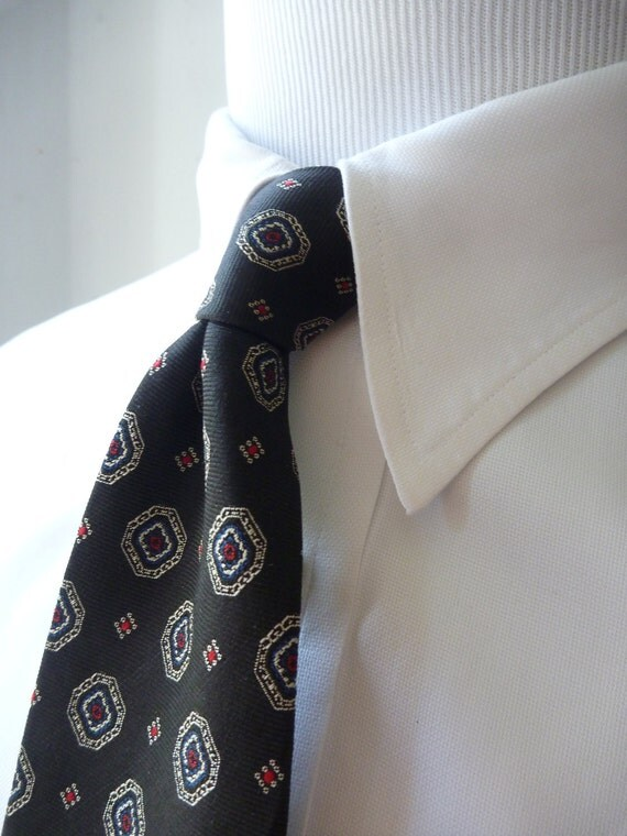 Vintage Brooks Brothers All Silk Small Medallions on a Black Background Repp Trad / Ivy Tie.  Made in USA.