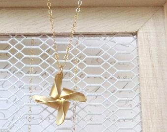 Gold Pinwheel Necklace