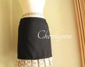 SALE Black Skirt with Loops Detail at The Hem