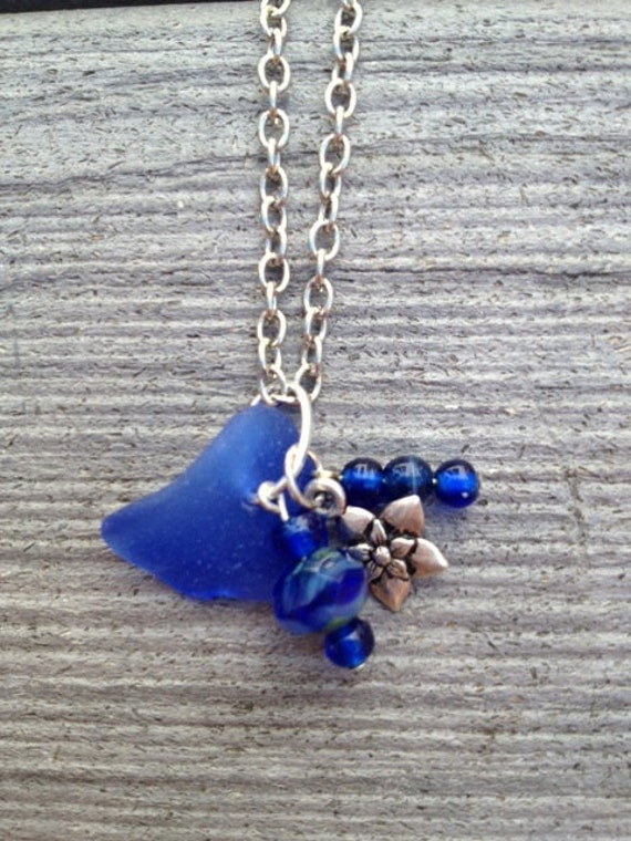 Cobalt blue sea glass pendant accented with czech glass bead and silver plated flower charm