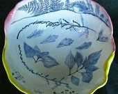 Large rose & yellow ceramic bowl with cobalt blue impressed Fern leaf designs.
