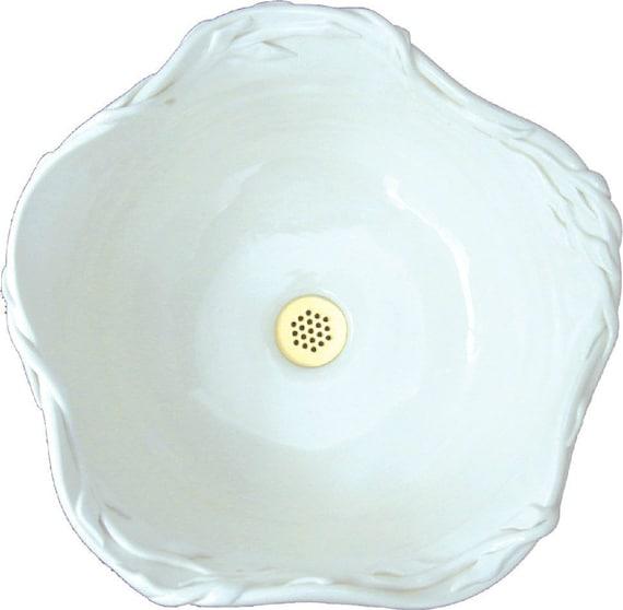 Snow Vessel Sink with Vining Leaf Rim in white.