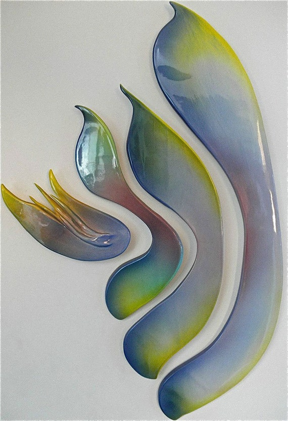 Nested Rainbow ceramic wall sculpture with airbrushed glazing.
