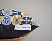 Industrial Haze Cushion Cover- A geometric pattern in shades of greys and black with a pop of yellow